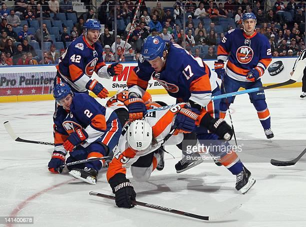 Matt Martin of the New York Islanders knocks down Scott Hartnell of the Philadelphia Flyers at the Nassau Veterans Memorial Coliseum on March 15 2012...