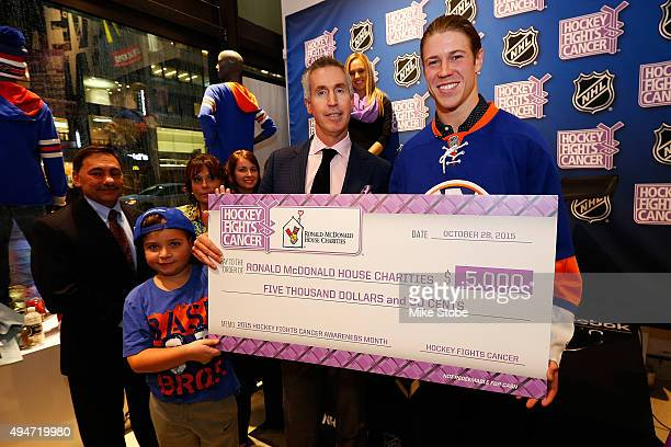 Matt Martin of the New York Islanders presents a check to the Ronald McDonald House Charities following a QA session to discuss Hockey Fights Cancer...