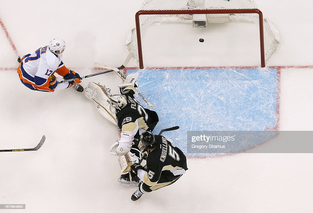Matt Martin #17 of the New York Islanders scores a second-period goal against <a gi-track='captionPersonalityLinkClicked' href=/galleries/search?phrase=Deryk+Engelland&family=editorial&specificpeople=3390067 ng-click='$event.stopPropagation()'>Deryk Engelland</a> #5 and <a gi-track='captionPersonalityLinkClicked' href=/galleries/search?phrase=Marc-Andre+Fleury&family=editorial&specificpeople=233779 ng-click='$event.stopPropagation()'>Marc-Andre Fleury</a> #29 of the Pittsburgh Penguins in Game Two of the Eastern Conference Quarterfinals during the 2013 NHL Stanley Cup Playoffs at Consol Energy Center on May 3, 2013 in Pittsburgh, Pennsylvania.