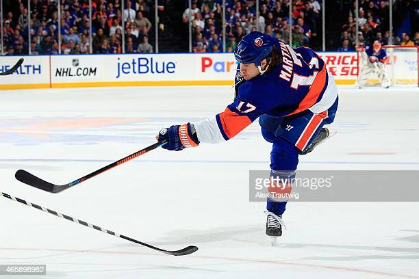Matt Martin of the New York Islanders takes a shot against the New York Rangers during a game at the Nassau Veterans Memorial Coliseum on March 10...