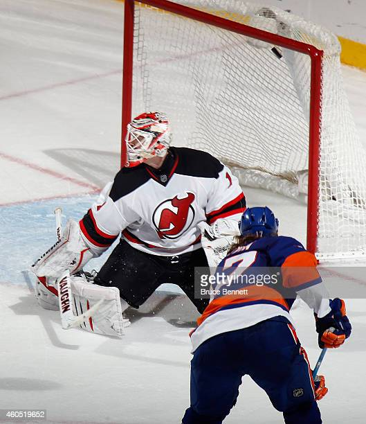 Matt Martin of the New York Islanders ties the score at 1045 of the second period against Keith Kinkaid of the New Jersey Devils at the Nassau...
