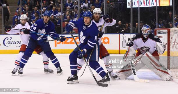 Matt Martin of the Toronto Maple Leafs and David Savard of the Columbus Blue Jackets and Brian Boyle of the Toronto Maple Leafs and William Karlsson...