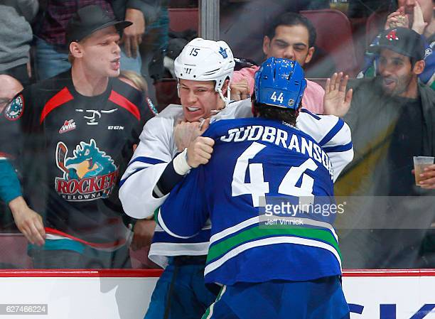 Matt Martin of the Toronto Maple Leafs and Erik Gudbranson of the Vancouver Canucks fight during their NHL game at Rogers Arena December 3 2016 in...