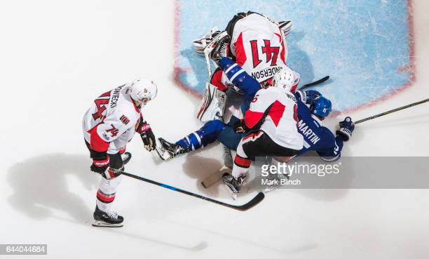 Matt Martin of the Toronto Maple Leafs crashes the net against Craig Anderson Mark Borowiecki and Chris Wideman of the Ottawa Senators during the...