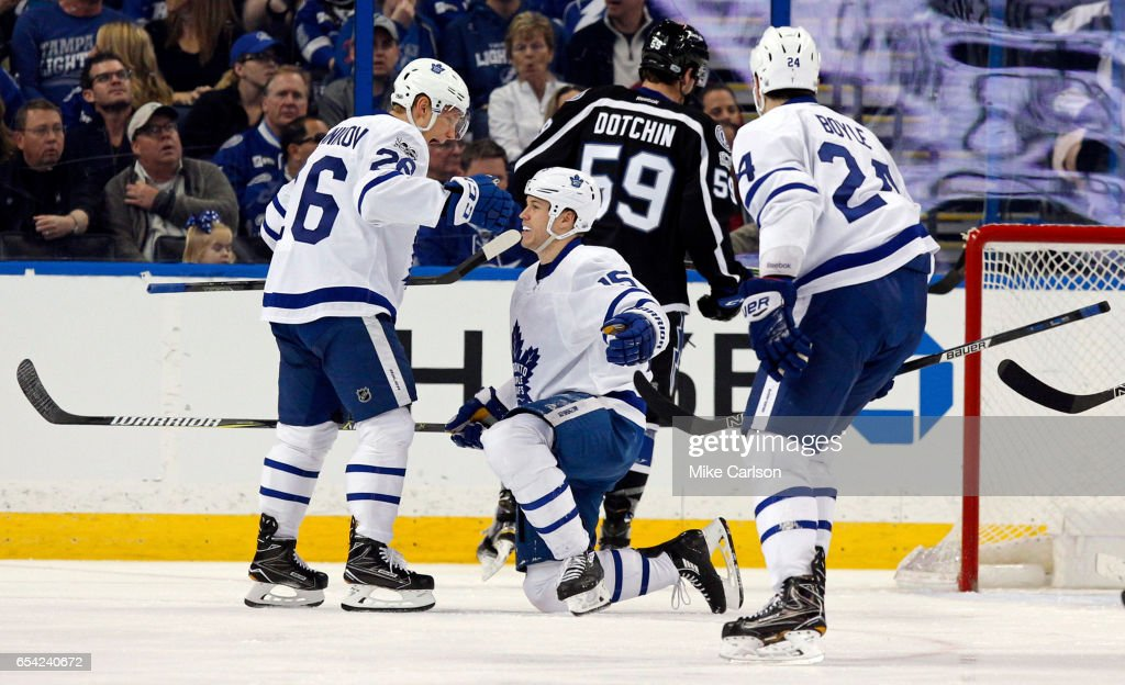 Matt Martin #15 of the Toronto Maple Leafs is congratulated by Nikita Soshnikov #26 after scoring against the Tampa Bay Lightning during the second period at the Amalie Arena on March 16, 2017 in Tampa, Florida.