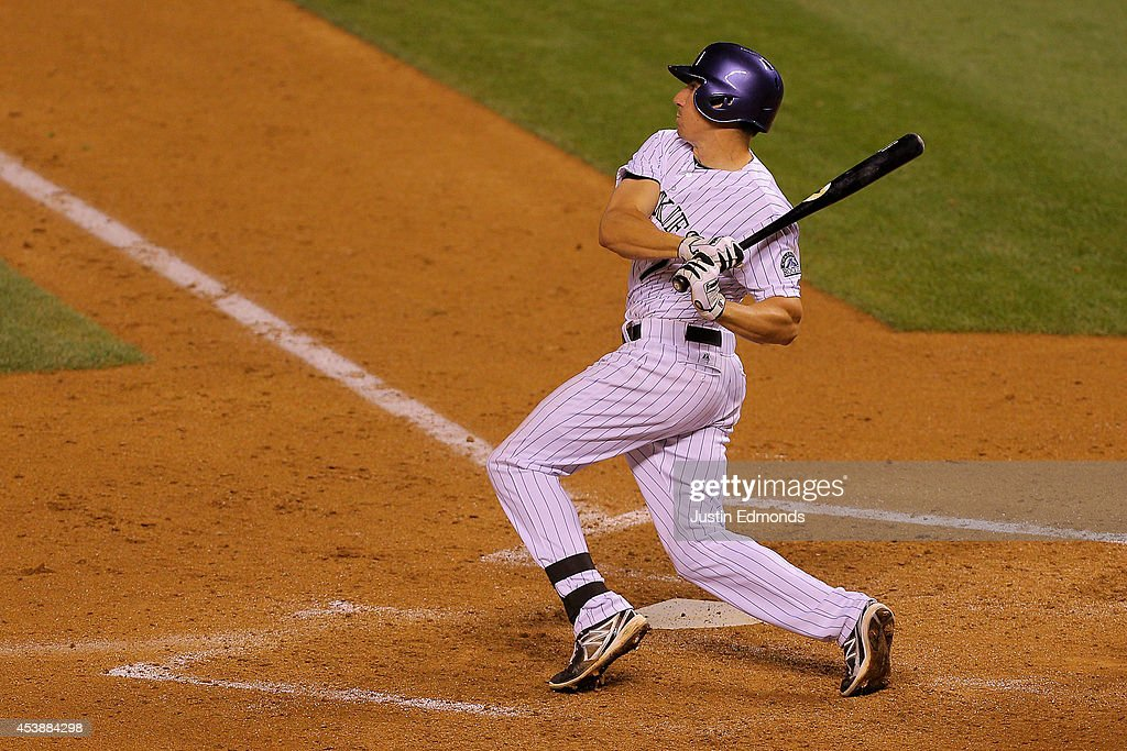 Matt McBride #7 of the Colorado Rockies hits a sixth-inning grand slam against the Kansas City Royals at Coors Field on August 20, 2014 in Denver, Colorado. The Rockies defeated the Royals 5-2.
