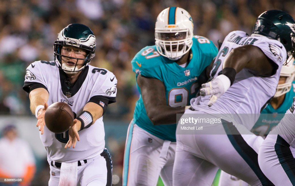 Matt McGloin #3 of the Philadelphia Eagles tosses the ball against Jordan Phillips #97 of the Miami Dolphins in the second quarter in the preseason game at Lincoln Financial Field on August 24, 2017 in Philadelphia, Pennsylvania. The Eagles defeated the Dolphins 38-31.