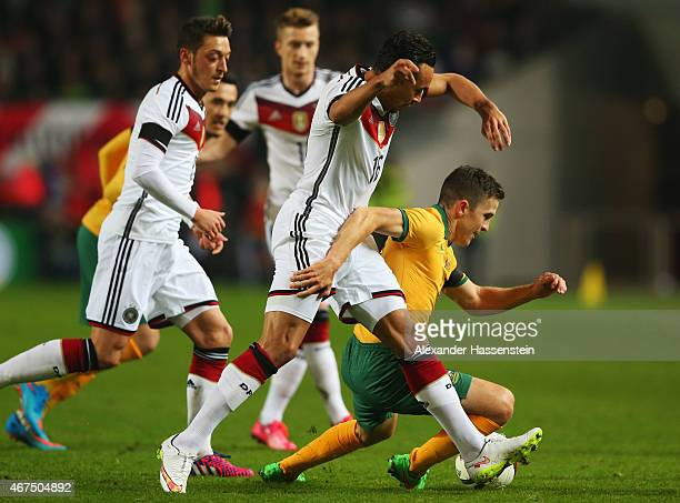 Matt McKay of Australia battles with Karim Bellarabi of Germany during the international friendly match between Germany and Australia at...
