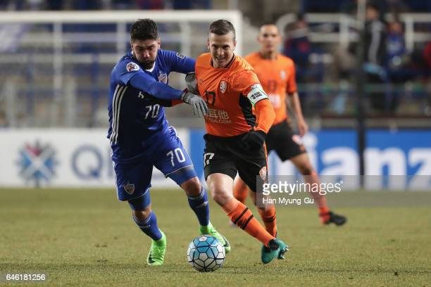 Matt Mckay of Brisbane Roar and Dimitrios Petratos of Ulsan Hyundai FC compete for the ball during the AFC Champions League Group E match between...