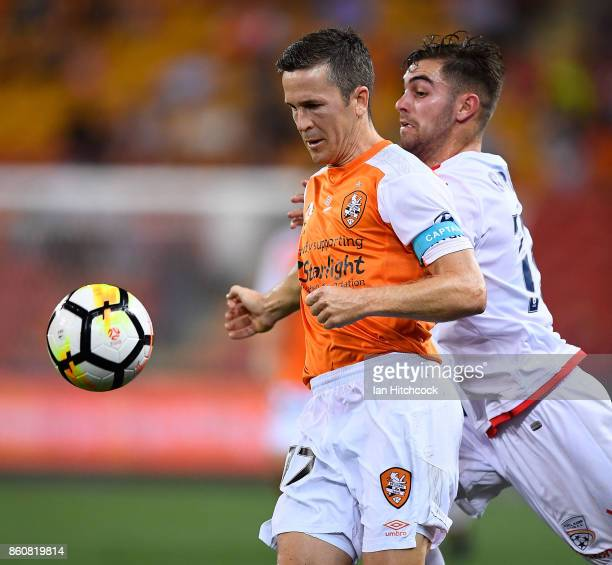 Matt McKay of the Roar and Ben Garuccio of Adelaide United contest the ball during the round two ALeague match between the Brisbane Roar and Adelaide...