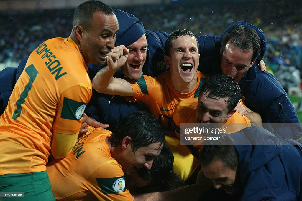 Matt McKay of the Socceroos (C) and team mates celebrate after Josh Kennedy scored a goal during the FIFA 2014 World Cup Asian Qualifier match between the Australian Socceroos and Iraq at ANZ Stadium on June 18, 2013 in Sydney, Australia.