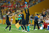 Matt McKay of the Socceroos substitutes for team mate Tim Cahill during the 2015 Asian Cup match between Australia and Korea Republic at Suncorp...