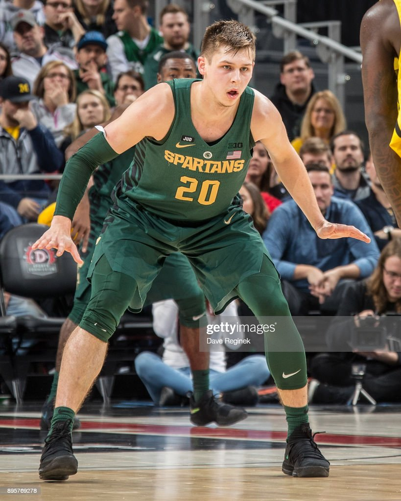 Matt McQuaid #20 of the Michigan State Spartans defends against the Oakland Golden Grizzlies during game two of the Hitachi College Basketball Showcase at Little Caesars Arena on December 16, 2017 in Detroit, Michigan. The Spartans defeated the Grizzles 86-73.