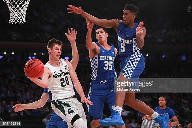 Matt McQuaid of the Michigan State Spartans throws a pass defended by Derek Willis and Malik Monk of the Kentucky Wildcats in the second half during...