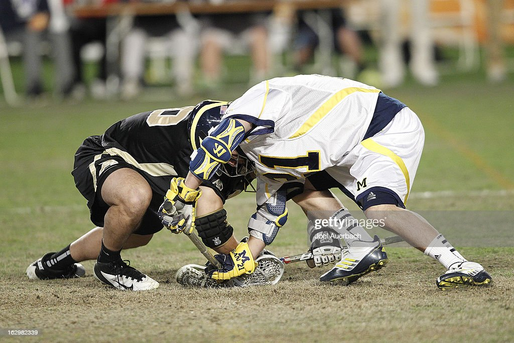 Matt Mezer #16 of the Army Black Knights and Brad Lott #20 of the Michigan Wolverines battle for possession of the ball during the 2013 Orange Bowl Lacrosse Classic on March 2, 2013 at SunLife Stadium in Miami Gardens, Florida.