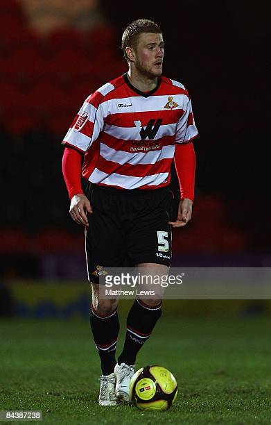 Matt Mills of Doncaster Rovers running with the ball during the FA Cup sponsored by Eon Third round Replay match betweeen Doncaster Rovers and...