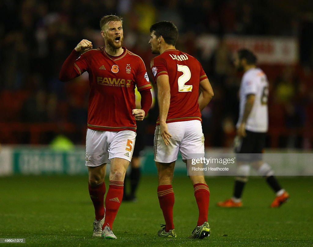Matt Mills of Forest celebrates at the final whistle during the Sky Bet Championship match between Nottingham Forest and Derby County at City Ground on November 6, 2015 in Nottingham, England.