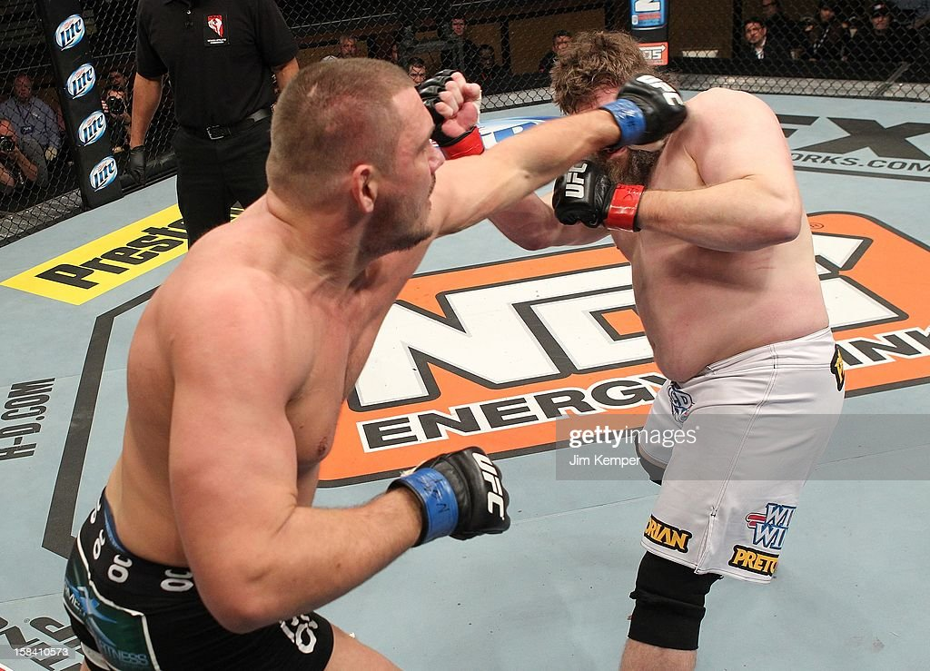 Matt Mitrione punches <a gi-track='captionPersonalityLinkClicked' href=/galleries/search?phrase=Roy+Nelson&family=editorial&specificpeople=4230645 ng-click='$event.stopPropagation()'>Roy Nelson</a> during their heavyweight fight at the TUF 16 Finale on December 15, 2012 at the Joint at the Hard Rock in Las Vegas, Nevada.