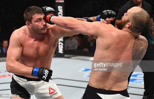 Matt Mitrione punches Travis Browne in their heavyweight bout during the UFC Fight Night event inside TD Garden on January 17 2016 in Boston...