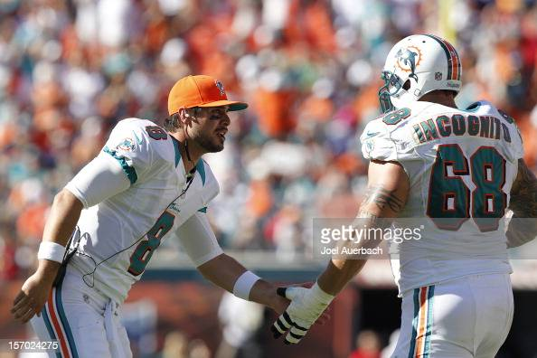 Matt Moore and Richie Incognito of the Miami Dolphins the teams touchdown against the Seattle Seahawks on November 25 2012 at Sun Life Stadium in...