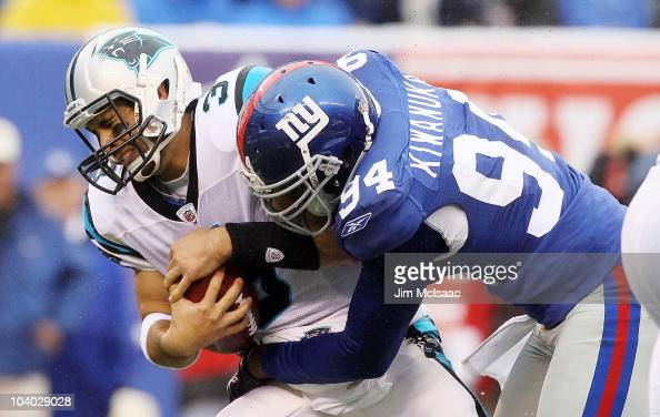 Matt Moore of the Carolina Panthers is sacked in the fourth quarter by Mathias Kiwanuka of the New York Giants on September 12 2010 at the New...