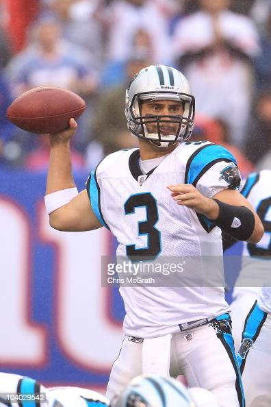 Matt Moore of the Carolina Panthers looks to pass against the New York Giants during the NFL season opener at New Meadowlands Stadium on September 12...