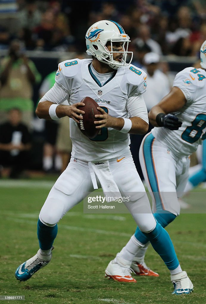 Matt Moore #8 of the Miami Dolphins drops back to pass against the Houston Texans during a preseaon game at Reliant Stadium on August 17, 2013 in Houston, Texas.