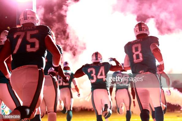 Matt Moore of the Miami Dolphins enters the field prior turnover the game against the Cincinnati Bengals at Sun Life Stadium on October 31 2013 in...