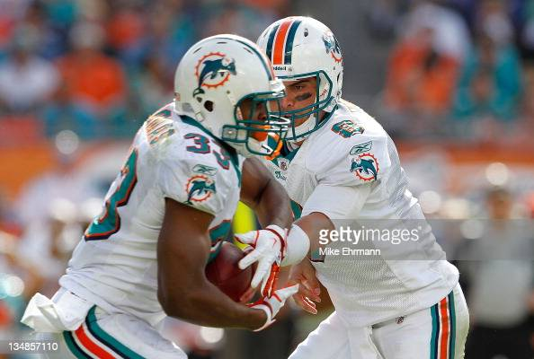 Matt Moore of the Miami Dolphins hands off to Daniel Thomas during a game against the Oakland Raiders at Sun Life Stadium on December 4 2011 in Miami...