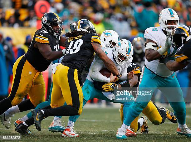 Matt Moore of the Miami Dolphins is sacked by Bud Dupree of the Pittsburgh Steelers in the second half during the AFC Wild Card Playoff game at Heinz...