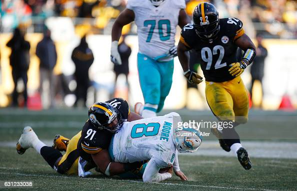 Matt Moore of the Miami Dolphins is wrapped up for a tackle by Stephon Tuitt of the Pittsburgh Steelers in the second half during the AFC Wild Card...