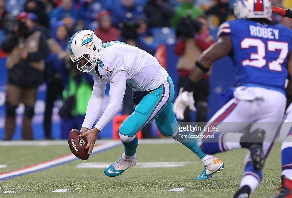 Matt Moore #8 of the Miami Dolphins recovers a fumble during NFL game action against the Buffalo Bills at Ralph Wilson Stadium on December 22, 2013 in Orchard Park, New York.