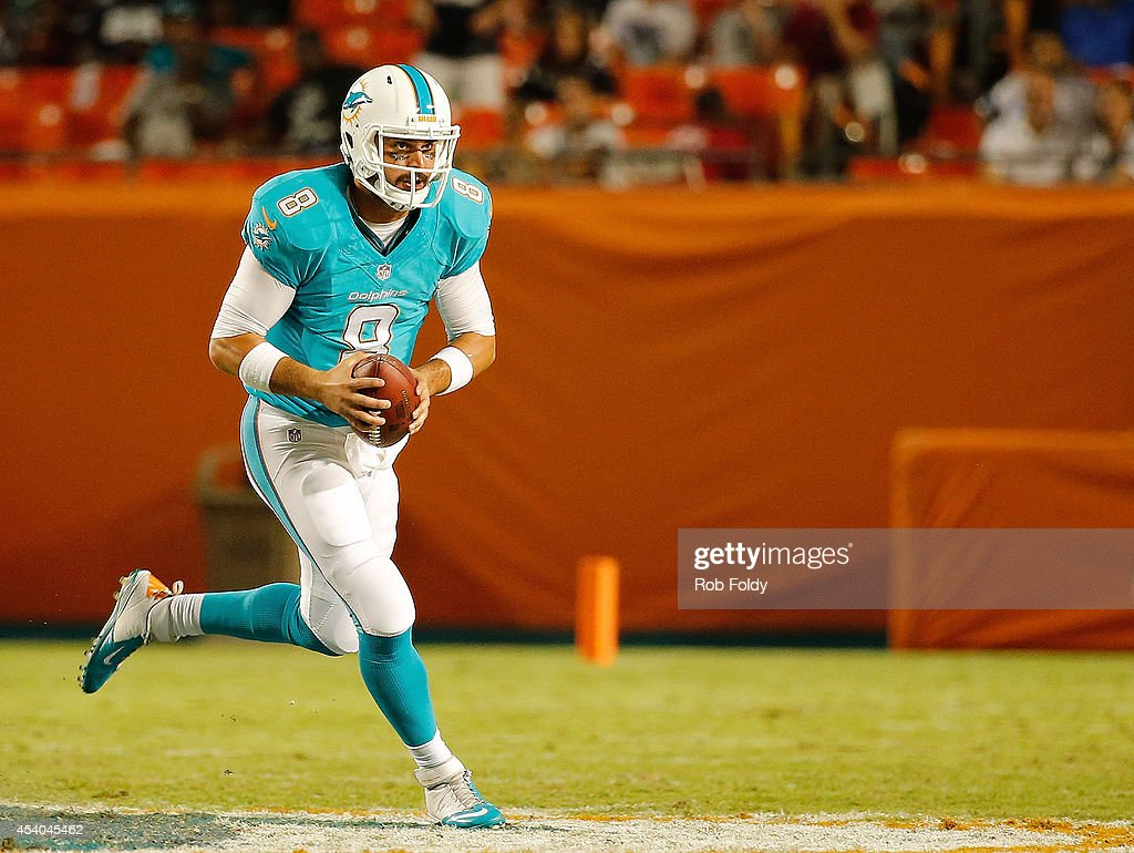Matt Moore #8 of the Miami Dolphins rushes during the game against the Dallas Cowboys at Sun Life Stadium on August 23, 2014 in Miami Gardens, Florida.
