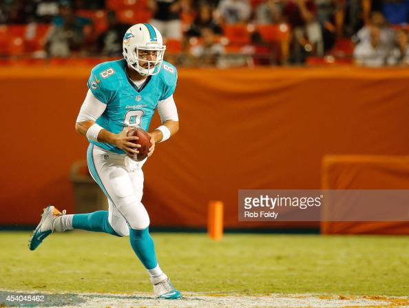 Matt Moore of the Miami Dolphins rushes during the game against the Dallas Cowboys at Sun Life Stadium on August 23 2014 in Miami Gardens Florida