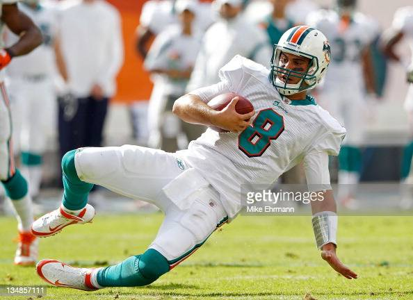 Matt Moore of the Miami Dolphins slides for a first down during a game against the Oakland Raiders at Sun Life Stadium on December 4 2011 in Miami...