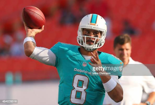 Matt Moore of the Miami Dolphins throws during warmups before a preseason game against the Dallas Cowboys at Sun Life Stadium on August 23 2014 in...