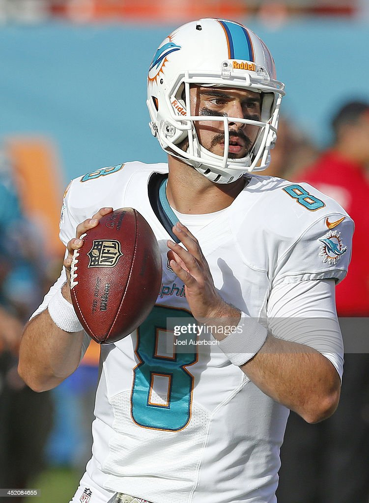 Matt Moore #8 of the Miami Dolphins throws the ball prior to the game against the San Diego Chargers on November 17, 2013 at Sun Life Stadium in Miami Gardens, Florida. The Dolphins defeated the Chargers 20-16.