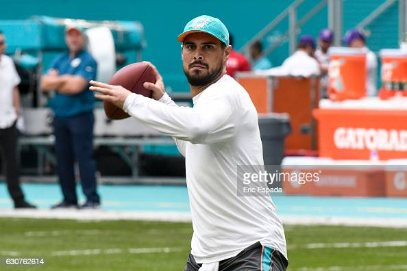 Matt Moore of the Miami Dolphins warms up before the start of the game against the New England Patriots at Hard Rock Stadium on January 1 2017 in...