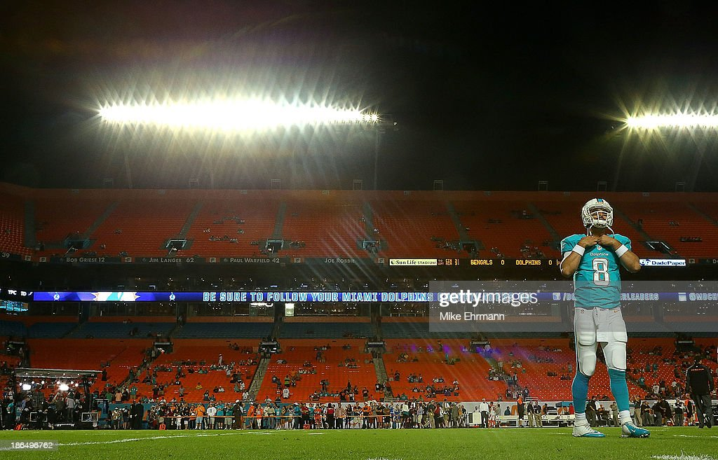 Matt Moore #8 of the Miami Dolphins warms up during a game against the Cincinnati Bengals at Sun Life Stadium on October 31, 2013 in Miami Gardens, Florida.