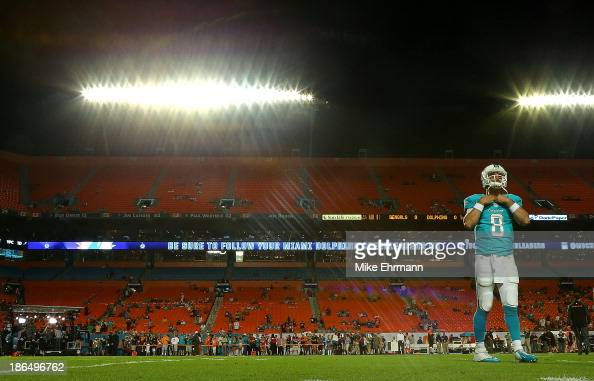 Matt Moore of the Miami Dolphins warms up during a game against the Cincinnati Bengals at Sun Life Stadium on October 31 2013 in Miami Gardens Florida
