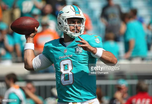 Matt Moore of the Miami Dolphins warms up during a game against the Jacksonville Jaguars at EverBank Field on September 20 2015 in Jacksonville...