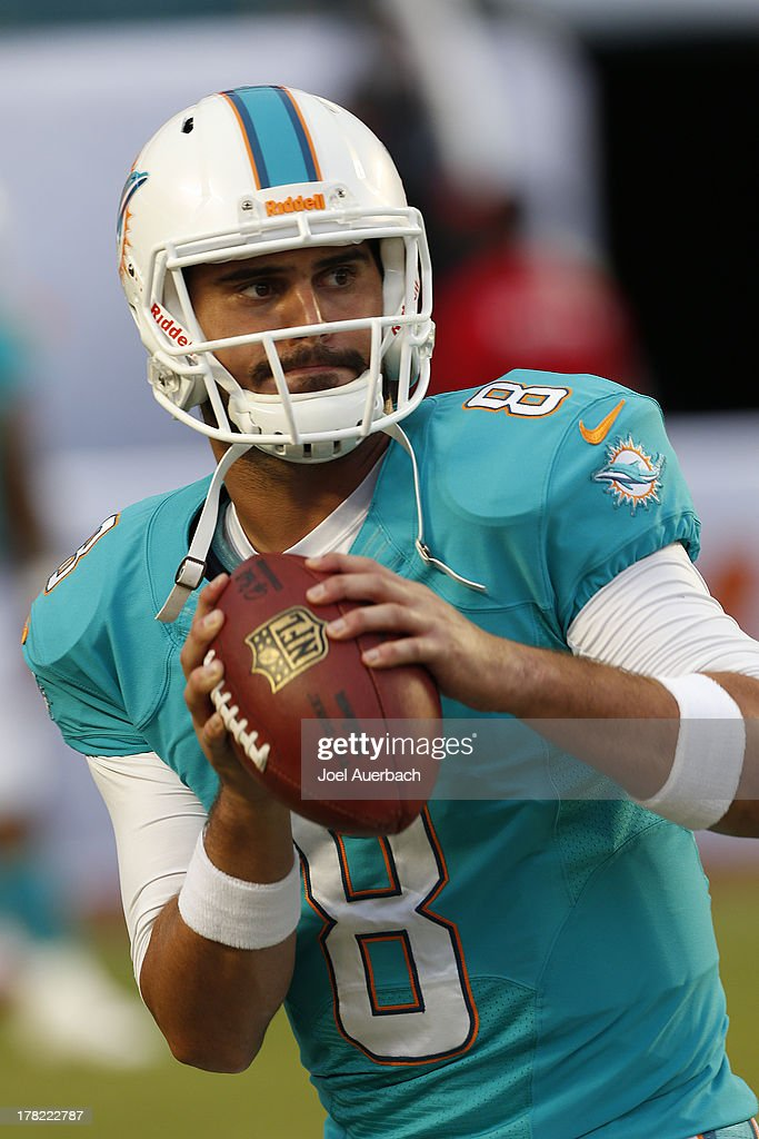 Matt Moore #8 of the Miami Dolphins warms up prior to the preseason game against the Tampa Bay Buccaneers on August 24, 2013 at Sun Life Stadium in Miami Gardens, Florida. The Buccaneers defeated the Dolphins 17-16.