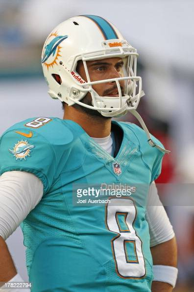 Matt Moore of the Miami Dolphins warms up prior to the preseason game against the Tampa Bay Buccaneers on August 24 2013 at Sun Life Stadium in Miami...