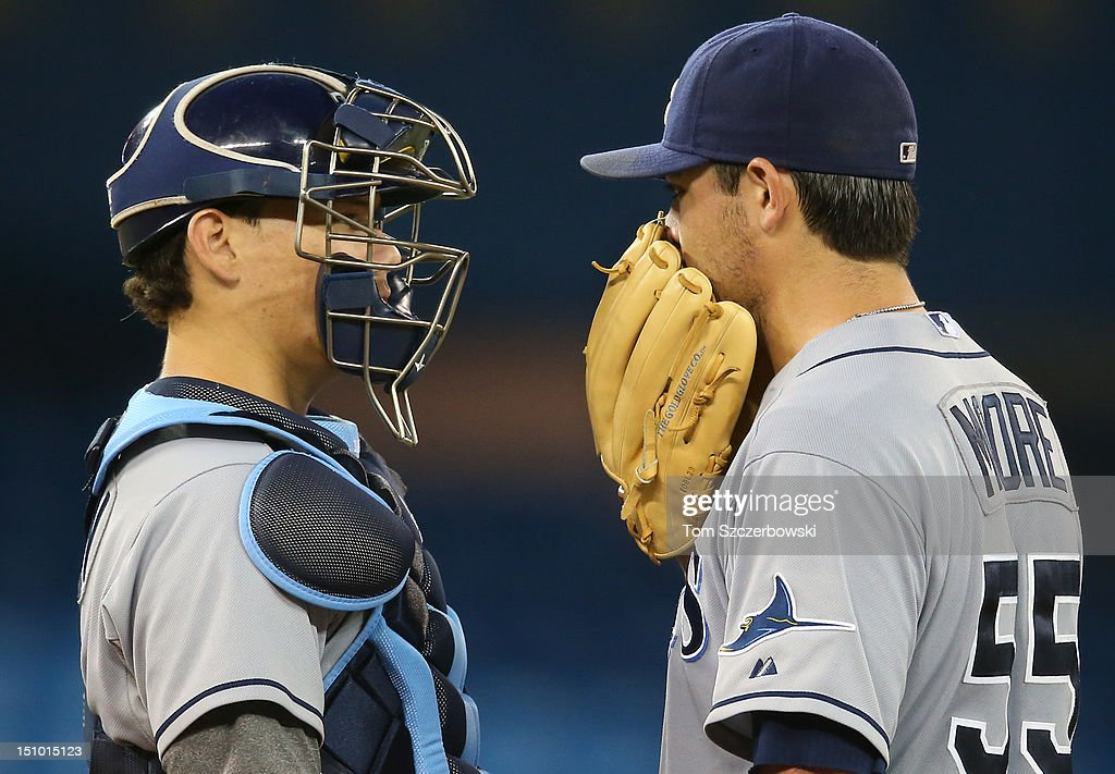 <a gi-track='captionPersonalityLinkClicked' href=/galleries/search?phrase=Matt+Moore+-+Baseball+Player&family=editorial&specificpeople=15003307 ng-click='$event.stopPropagation()'>Matt Moore</a> #55 of the Tampa Bay Rays confers with Jose Lobaton #21 during MLB game action against the Toronto Blue Jays on August 30, 2012 at Rogers Centre in Toronto, Ontario, Canada.
