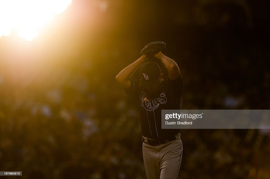 <a gi-track='captionPersonalityLinkClicked' href=/galleries/search?phrase=Matt+Moore+-+Baseball+Player&family=editorial&specificpeople=15003307 ng-click='$event.stopPropagation()'>Matt Moore</a> #55 of the Tampa Bay Rays winds up to deliver a pitch against the Colorado Rockies in the third inning of a game at Coors Field on May 3, 2013 in Denver, Colorado. The Rockies led the Rays 3-2 after three innings.