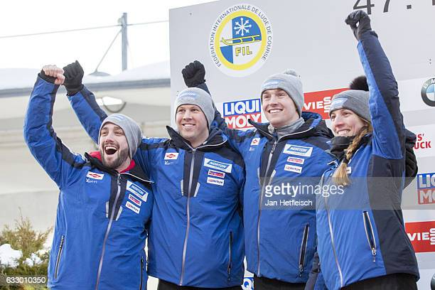 Matt Mortensen Jayson Terdiman Tucker West and Erin Hamlin celebrate the winning of the second place in the Team Luge competition during the third...