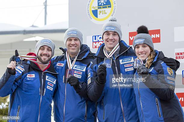 Matt Mortensen Jayson Terdiman Tucker West and Erin Hamlin of the United States celebrate the winning of the second place in the Team Luge...