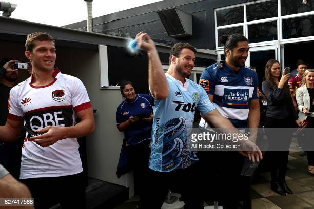 Matt Moulds throws a paint bomb at a map of New Zealand during the Mitre 10 Cup Season Launch at the College Rifles Rugby Union Football Sports Club...