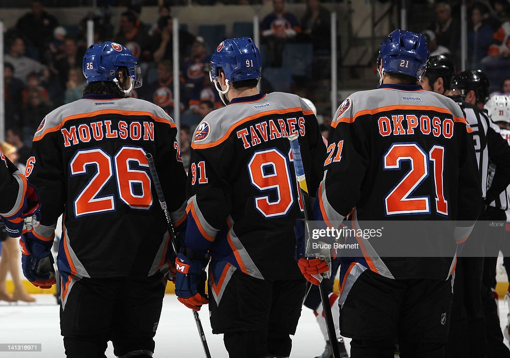 <a gi-track='captionPersonalityLinkClicked' href=/galleries/search?phrase=Matt+Moulson&family=editorial&specificpeople=3365493 ng-click='$event.stopPropagation()'>Matt Moulson</a> #26, <a gi-track='captionPersonalityLinkClicked' href=/galleries/search?phrase=John+Tavares&family=editorial&specificpeople=601791 ng-click='$event.stopPropagation()'>John Tavares</a> #91 and <a gi-track='captionPersonalityLinkClicked' href=/galleries/search?phrase=Kyle+Okposo&family=editorial&specificpeople=540469 ng-click='$event.stopPropagation()'>Kyle Okposo</a> #21 of the New York Islanders skate against the Washington Capitals at the Nassau Veterans Memorial Coliseum on March 13, 2012 in Uniondale, New York.