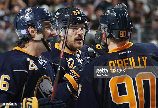 Matt Moulson Marcus Foligno and Ryan O'Reilly of the Buffalo Sabres celebrate a win against the Toronto Maple Leafs at First Niagara Center on...